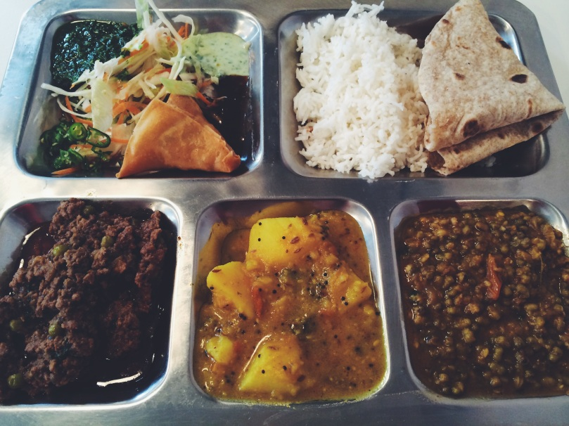 Spiced lamb curry, bombay potatoes and a dahl (lentil) dish, served with a samosa, chutney, rice & chapati