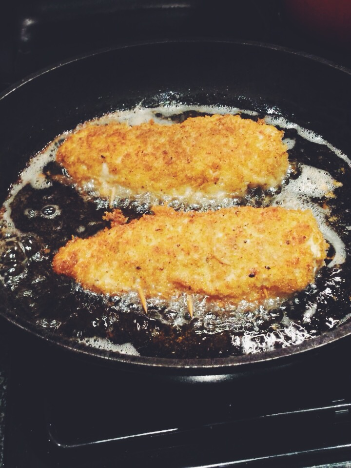 Chicken Kiev's shallow frying in sunflower oil